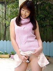 Asian teen is a model in her pink clothes