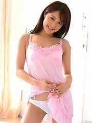 Hot Asian babe is removing her pink nightie