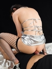 Fishnets-wearing hottie Reo Saionji mock-riding a guy's cock in an assjob gallery
