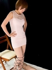 Strict seductress Kaede Oshiro flattens this dude's cock and balls for his pleasure
