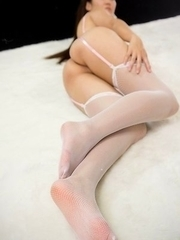 Stockings-clad Madoka Yukishiro teasing with her sexy ass and sexier soles
