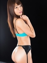 Long-haired hottie Shino Aoi shows her stocking-clad legs and gives an assjob