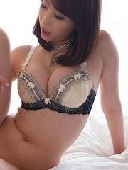 Aya Kisaki shows her toes while stroking this dude's throbbing boner