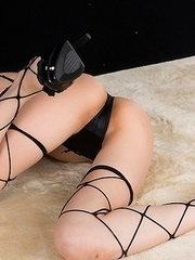 Fishnets-clad babe Ayaka Mikami wearing heels during her latest posing session