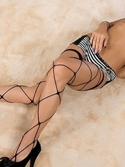 Nanami Sugisaki shows her tanned legs in fishnets before getting her thighs fucked