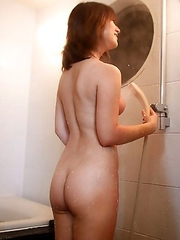 Yuki Minami joins us in the shower and gives our meat puppets cock a good tugging