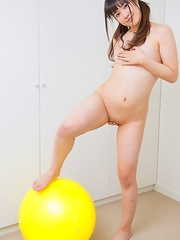 Masako gets wild and naked for big bouncy balls!