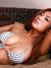 Kana Tsugihara with huge hooters poses so sexy in bath suit