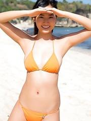 Kaho Takashima in orange swimming suit i playful on beach