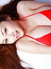 Anri Sugihara shows big melons while playing in water