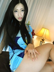 Mitsu Dan with long beautiful hair shows curves in lingerie
